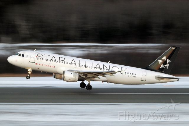 Airbus A320 (C-FDRH) - A few minutes after sunset, 1/30s exposure handheld with 500mm equivalent focal length