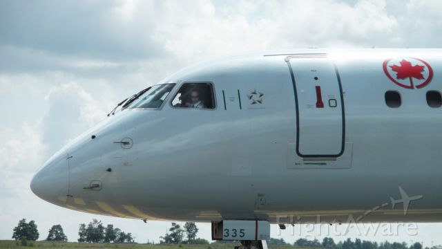 C-FMZD — - Captain about to wave as he taxis to Runway 25 2009:08:11. 14:45