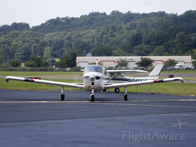 Beechcraft Sundowner (N9775L) - Taxiing out of the Executive Air ramp.