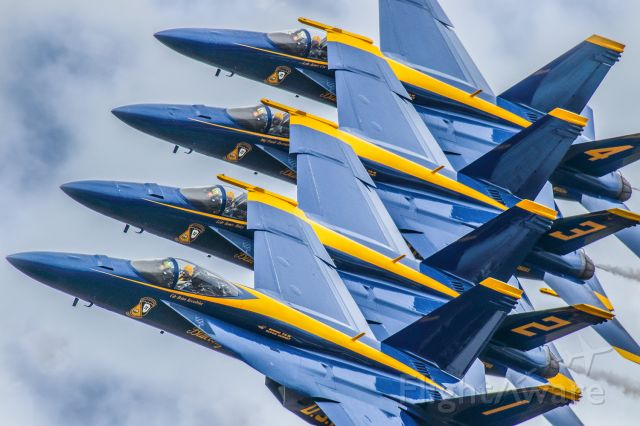 McDonnell Douglas FA-18 Hornet — - This photo is from the VERY FIRST performance where the Blue Angels debuted the FA18 SUPER HORNET as their new aircraft. I personally really love this photo and I hope everyone else does as well. The symmetry is about as perfect as possible. You can clearly see the Commander in the number 1 aircraft looking ahead and the other three pilots are concentrating on the aircraft to their left.The show was at the Sun N Fun aerospace expo in Lakeland Florida April 2021. I used 600mm of Canon lens and the camera settings were 1/8000 F5.6 ISO 800. Please check out my other photography. Positive votes and comments are always appreciated.