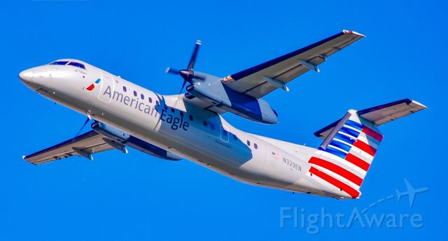 de Havilland Dash 8-100 (N329EN) - Really miss these old Dash 8s.  Charlotte is a little less interesting without them.