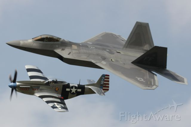"""— — - North American P-51K """"Fragile but Agile"""" with the USAF ACC Lockheed Martin F-22 Raptor Demo performing a USAF Heritage Flight at the 2015 New York Airshow"""