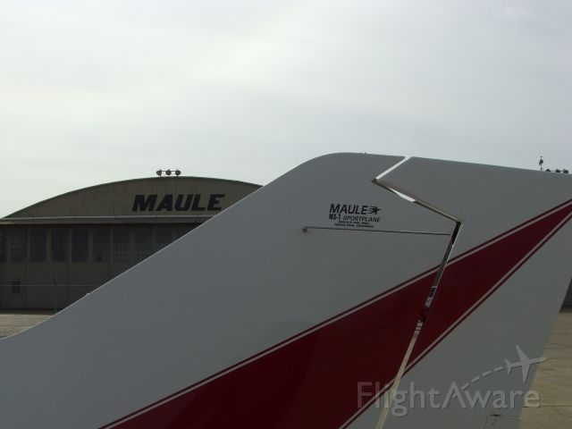 N41510 — - Maule MX7-160 tail with Maule Flight factory service center in the background. Taken at Spence Field in Moultrie, GA where the Maule factory is located.