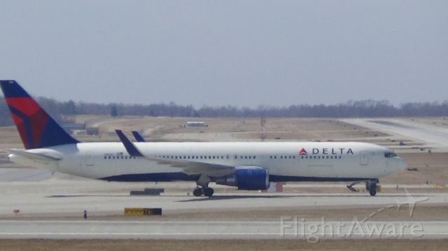 N1605 — - With a stiff cross wind, Delta 223 arriving from Paris Charles De Guile at 2:19 P.M. bounces three times and finally touches down at the 4000 ft.!!   Taken March 12, 2015.