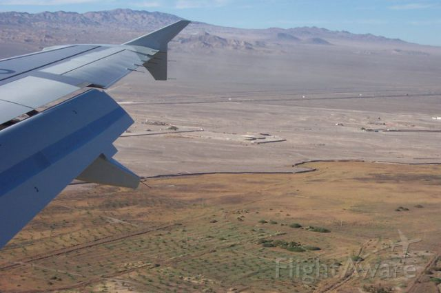 "— — - LAN Chile, approaching Calama airport in the ""norte chico"" (small North) of Chile."