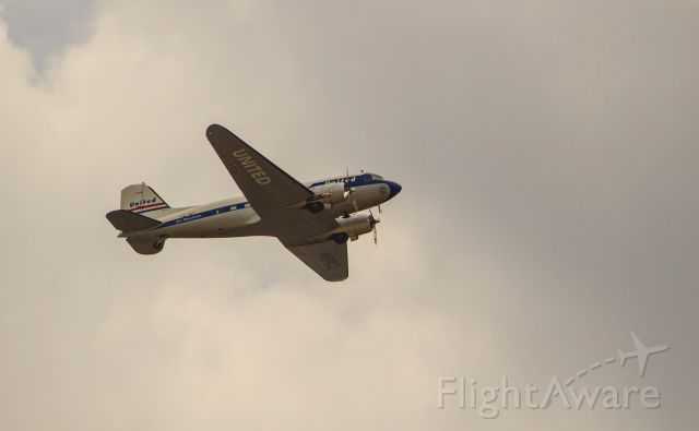 """Douglas DC-3 (N814CL) - Clay Lacys DC-3 flying westbound out of Long Beach Airport on Sunday, July 27, 2014.  Dubbed"""" Mainliner OConnor""""; in honor of Mary OConnor, one of United Airlines first flight attendants. OConnor had a fascinating aviation career:  see """"a rel=nofollow href=http://navymedicine.navylive.dodlive.mil/archives/4717http://navymedicine.navylive.dodlive.mil/archives/4717/a and her book:   Flying: The Story of a Pioneer Stewardess"""
