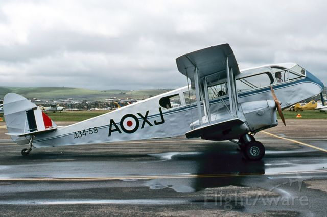 De Havilland Canada Twin Otter (VH-AQU) - DE HAVILLAND DH-84 DRAGON - REG : VH-AQU (CN DHA2048) - PARAFIELD AIRPORT ADELAIDE SA. AUSTRALIA - YPPF 27/9/1982