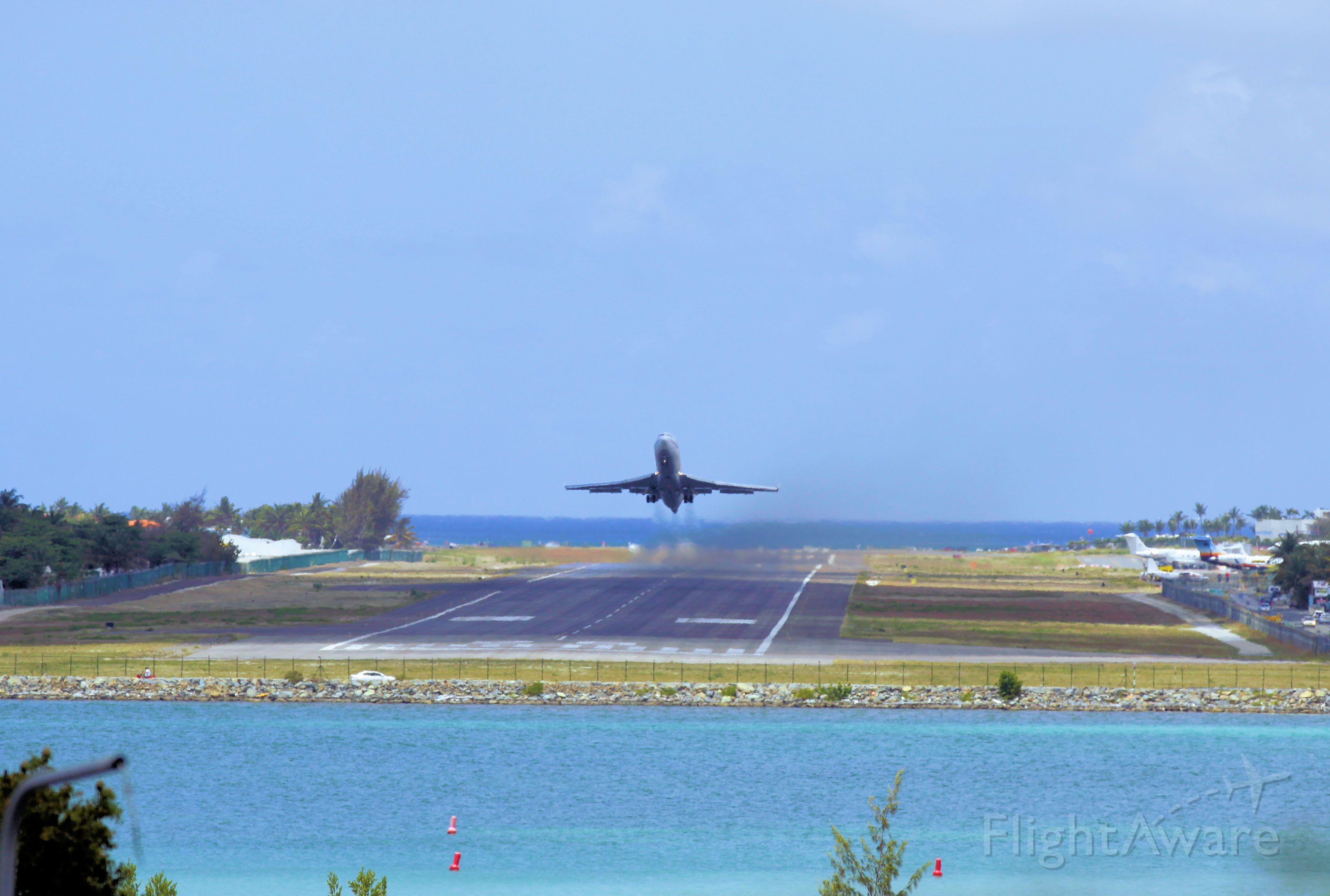 BOEING 727-200 (N395AJ) - AmeriJet 727 N395AJ departing TNCM