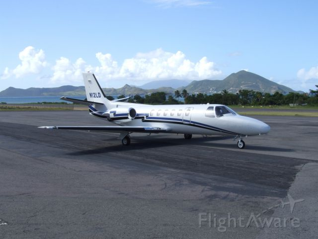 Cessna Citation II (N12LD) - Standing on the ramp in Nevis with St. Kitts in the background.