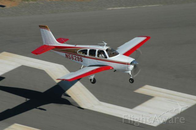 Beechcraft Bonanza (33) (N5629S) - Landing on runway 25 at Auburn, CA (KAUN). Photo by Andy Robinson.