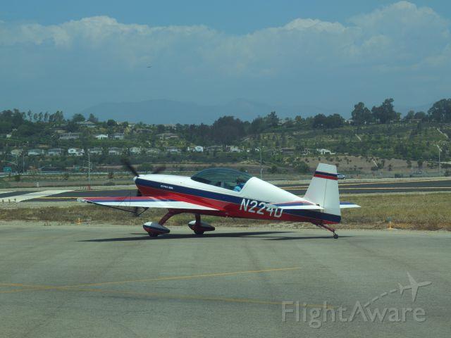 Beechcraft Baron (58) (N224D) - Extra 300L in run-up area at Camarillo, CA