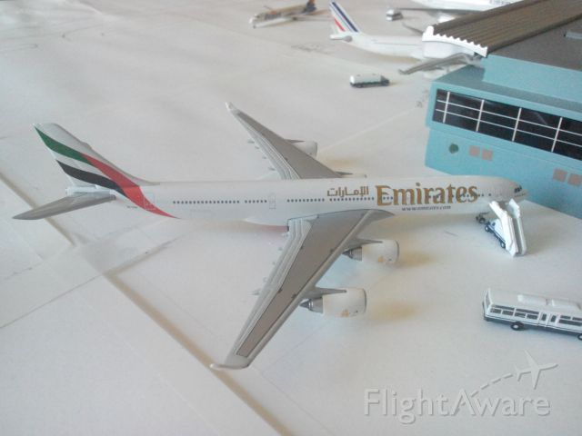 Airbus A340-500 (A6-ERH) - Pic of one if my favorite models. This Emirates A340-500 is boarding for it