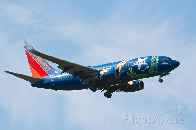 Boeing 737-700 (N727SW) - Southwest Airlines N727SW Nevada One seen landing on 33L August 11, 2012.
