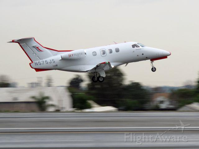 Embraer Phenom 100 (N575JS) - Take off at SMO.