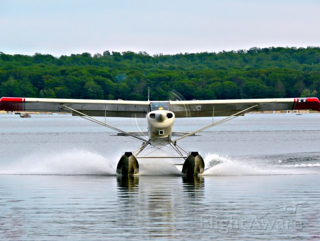 CHRISTEN Husky (N537MM) - 7MM landing and taxiing into the Otsego Lake Splash-In