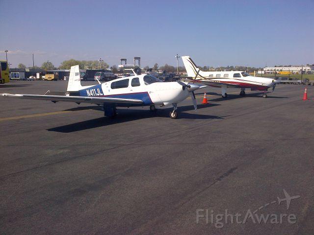 Mooney M-20 Turbo (N411JL) - The little guys on the flight line at Logan