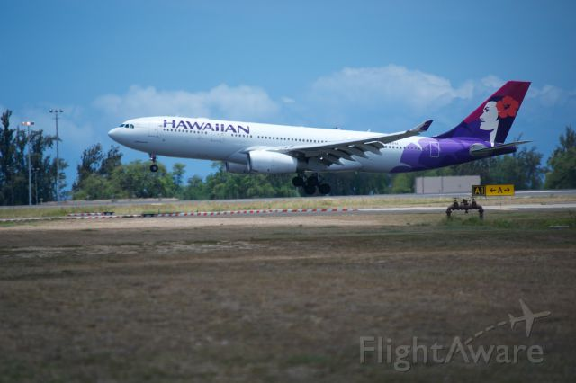 Airbus A330-200 — - Hawaiian A330-200 about to smoke the mains on runway 8L at PHNL.