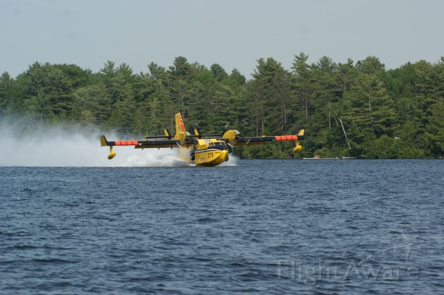 Canadair CL-41 Tutor (C-GOGW) - Crystal Lake, Ontario taken from our boat we had an awesome view as two SuperScoopers fought a nearby forest fire we could not see.