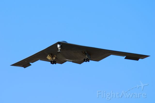 — — - B-2 landing at Whiteman AFB.