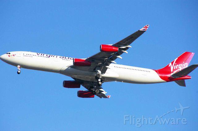 Airbus A340-300 (G-VSUN) - VIR21 landing at KIAD on 12/28/11.