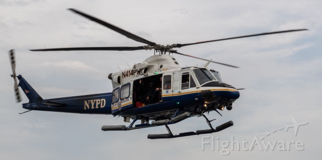 Bell 412 (N414PD) - New York Police Department's Bell 412EP helicopter flying over New York Harbor during the Navy SEAL Hudson River Swim and Run on 8/7/21.
