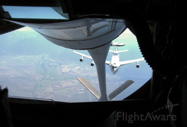 — — - KC-135 and E-3 preparing for arial refuel.  As seen from the boom operators position.