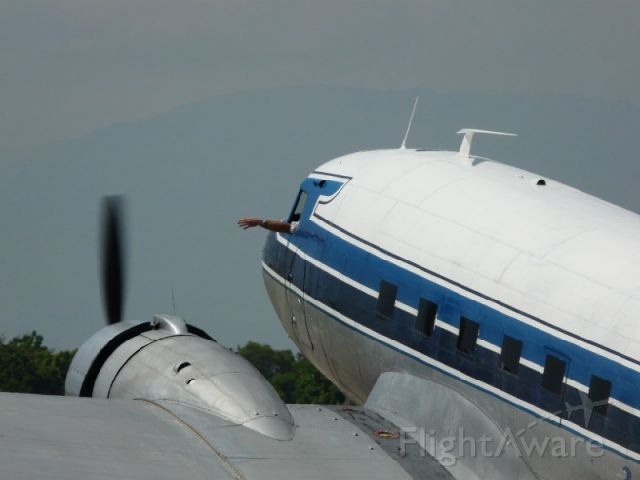 Douglas DC-3 (N300MF) - Trying to get some fresh air.