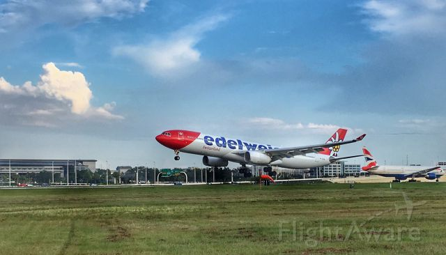 Airbus A330-300 — - Edelweiss arriving at TPA as British Airways waits to depart.