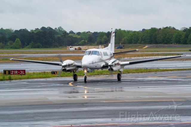 N377P — - Arriving on a wet evening at PDK>