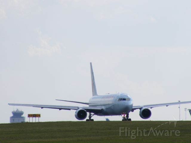 C-FMWU — - taxiing towards #25 with control tower in background