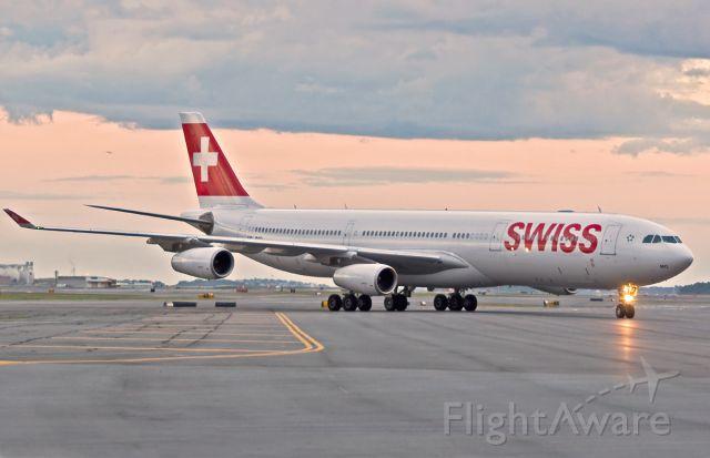 Airbus A340-300 (HB-JMO) - Hot Swiss sunset arrival @ KBOS Logan Airport Boston,Ma