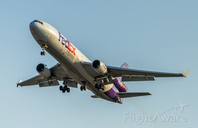 Boeing MD-11 (N618FE) - FEDEX pulls up just shy of runway 05 due to a tardy exit by the previous arrival