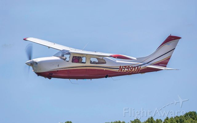 Cessna Centurion (N7591N) - This was a low altitude, high-speed fly-by for the camera. Photo credit: Barbara Houston, 2019.