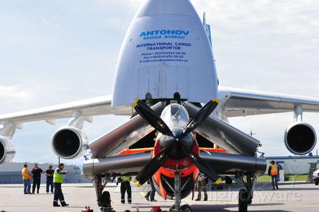 Antonov An-124 Ruslan (ADB1714) - Loading Gannet aircraft for shipping to USA south ramp Goose Bay