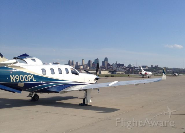 Socata TBM-850 (N900PL) - A new TBM 900 at KMKC with downtown Kansas City in the background. Dont care if FlightAware thinks its an 850.
