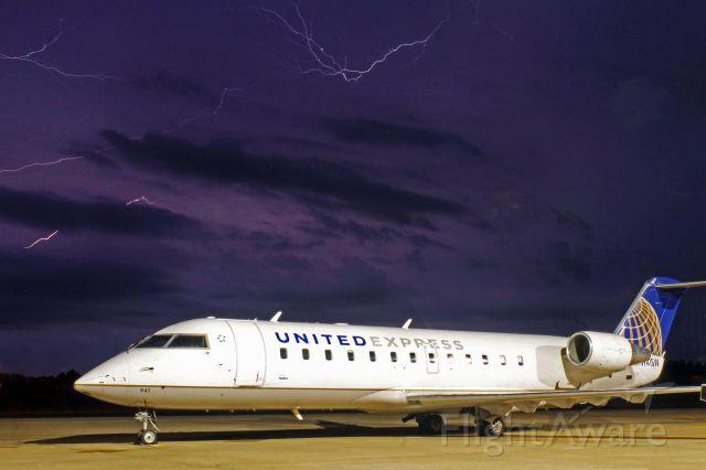 Canadair Regional Jet CRJ-100 (N941SW) - SKW CRJ-200 prepares to weather an approaching storm.
