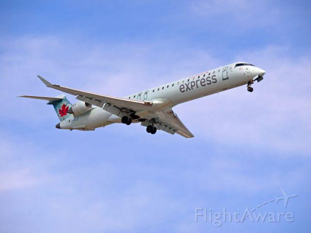 Canadair Regional Jet CRJ-900 (C-FCJZ) - An Air Canada Express / Jazz CRJ 900 on final approach to CYWG / Winnipeg.