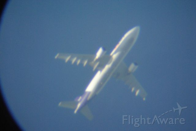 Airbus A300F4-600 — - This is taken through a telescope so there is no reason for bad votes unless you expect more than you get...