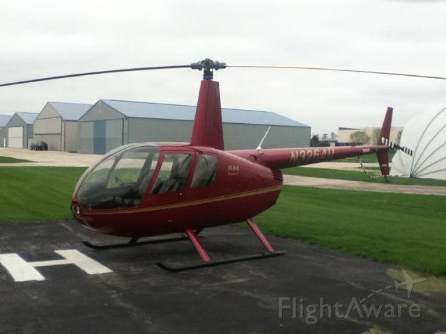 Robinson R-44 (N3264U) - Parked on the Helipad.
