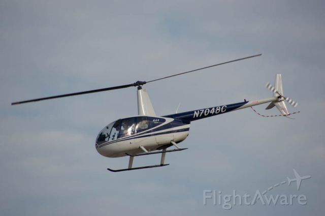 Robinson R-44 (N7048C) - In this image a Robinson R44 is taking passengers on. helicopter rides around Boone, Iowa before and after the air space was closed for the Fly Iowa Airshow 2019.  Photo taken August 2, 2019 with Nikon D3200 at 400mm.
