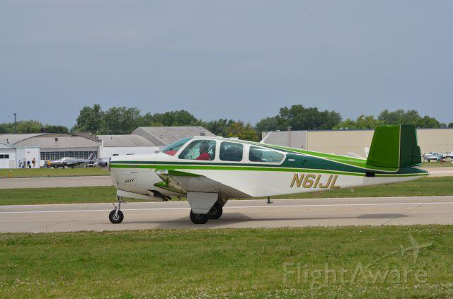 Beechcraft 35 Bonanza (N61JL) - Bonanza mass arrival at AirVenture 2014