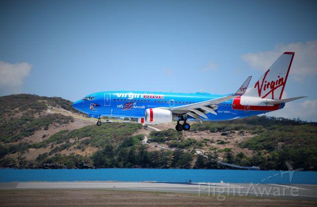Boeing 737-700 (VH-VBY) - Virgin Blues (now Virgin Australia) 50th aircraft landing RWY 14 Hamilton Island, Qld