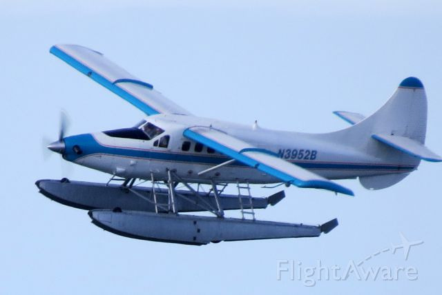 De Havilland Canada DHC-3 Otter (N3952B) - Key West Seaplanes flying out of Key West International on a checkout flight in the evening after two days of cancelled flights due to torrential rains and thunderstorms.