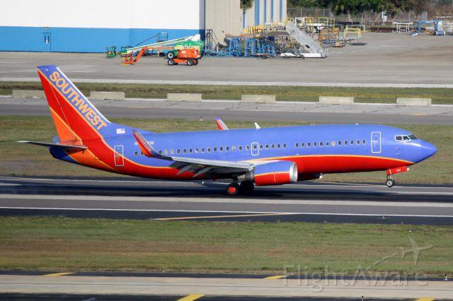 BOEING 737-300 (N643SW) - Southwest Flight 1802 (N643SW) arrives on Runway 19L at Tampa International Airport following a flight from Birmingham-Shuttlesworth International Airport