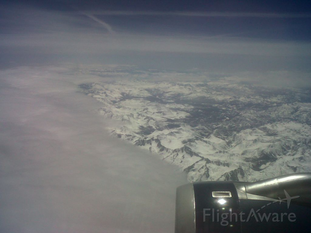 Airbus A320 — - Flying east out of SFO over the snow covered Sierra Nevada. US Airways Flight #658, KSFO-KPHL, aircraft is A320, picture taken on 4-16-12.