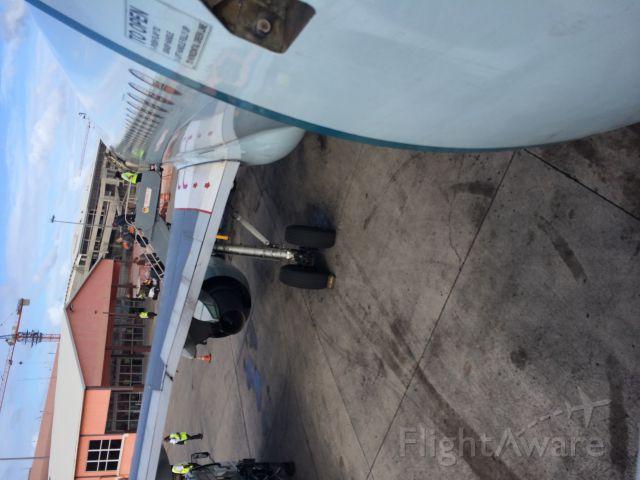 — — - Unloading in Antigua