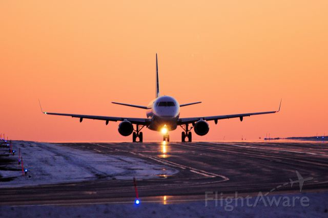 Embraer 170/175 (N643RW) - Taxiing to Rwy 25 for a trip to ORD/KORD at sunset.