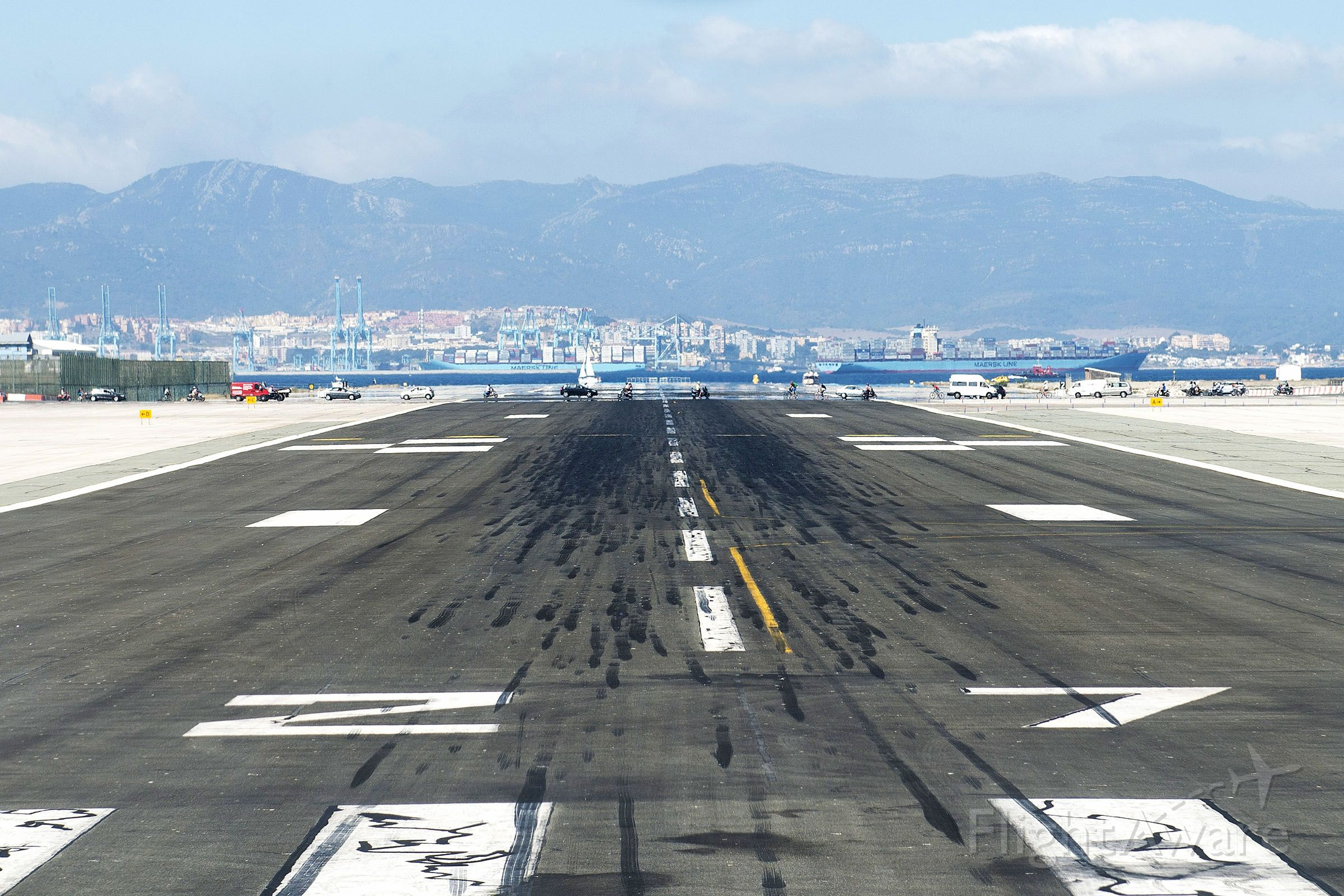 — — - Lined up on 27 for departure to EGHI - slight delay with vehicles crossing runway due to traffic lights being on GREEN! Amazing sight with Gibraltar Harbour and large ships beyond the end of the runway.