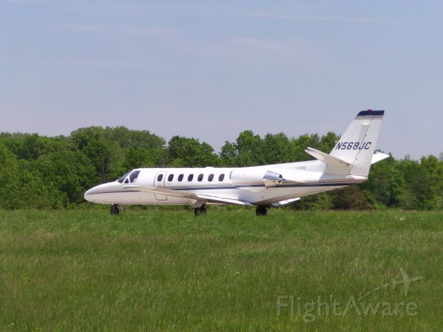 Cessna Citation V (N568JC) - In a field off taxiway. Aircraft was taxiing to RWY 24 for departure.
