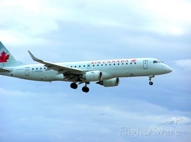 Embraer ERJ-190 (C-FMZW) - Landing 06L - April 27, 2014